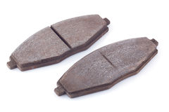 Car brake pads. Old rusty used car brake pads on a white background Royalty Free Stock Image