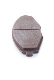 Car brake pads. Old rusty used car brake pads on a white background Stock Images