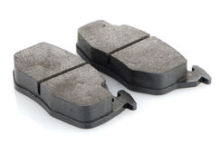 Car brake pads. On white reflective background Stock Photos