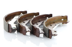 Car brake pads. On white reflective background Stock Photography