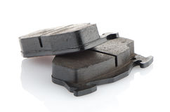Car brake pads. On white reflective background Royalty Free Stock Photos