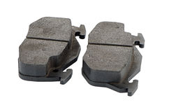 Car brake pads. On white reflective background Stock Photo
