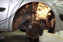 Car Brake Rotor. In automobile repair shop Stock Photo