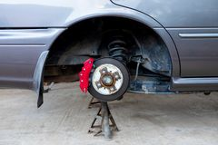 Car Brake and Suspension System Maintenance in the Local Area Garage.  stock photos