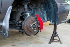 Car Brake and Suspension System Maintenance in the Local Area Garage.  stock images
