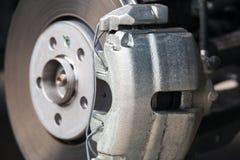Car brake system. Brake caliper close-up. New brake caliper stock photos