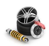 Car brakes with absorbers, tires and rims. On the white background Stock Photos