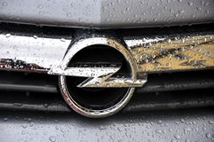 Car brand logo. Opel brand logo on a wet car Stock Photography