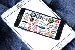 Car brands and logos. Collection of the famous car brands and logos on samsung mobile phone a5. Brands like mercedes , volkswagen , bmw , toyota , ford , audi royalty free stock photo