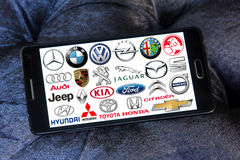 Car brands and logos. Collection of the famous car brands and logos on samsung mobile phone a5. Brands like mercedes , volkswagen , bmw , toyota , ford , audi Stock Image