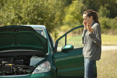 Car Breakdown. On the road, woman calling for help on a cellphone Stock Photography