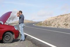 Car breakdown. Man having a car breakdown on the road stock photography