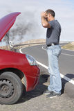 Car breakdown. Man having a car breakdown with engine trouble Royalty Free Stock Image