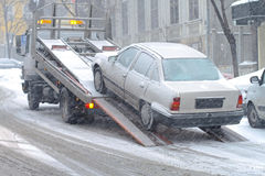 Car breakdown. And towing assistance at snowy day stock image