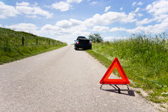 Car with a breakdown. Cabrio with a engine breakdown in a rural scene Stock Photos