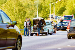 Car breakdown and chaos. Ronneby, Sweden - June 26, 2015: Car break down and cause some chaos on the street during a road cruise for veteran cars. Drunk Stock Image