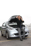Car breakdown. A man standing in front of a stalled car / car breakdown Stock Photography