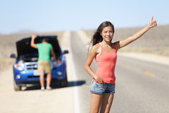Car breakdown problems - woman hitchhiking Stock Photos
