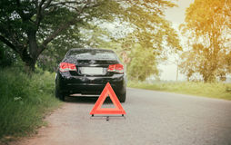 A car breakdown with Red triangle of a car on the road. A car breakdown with Red triangle a car on the road Royalty Free Stock Photo