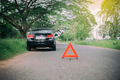A car breakdown with Red triangle of a car on the road. A car breakdown with Red triangle a car on the road Royalty Free Stock Photos