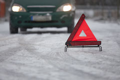Car breakdown with warning triangle Stock Images