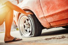 Car breakdown and wheel flat tire on the road in the city. Car breakdown and wheel flat tire in the parking royalty free stock photo