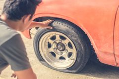 A car breakdown and wheel flat tire on the road in the city. stock photo