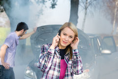 Car breakdown woman call for help. Car breakdown women call for help road assistance smoking engine Stock Image