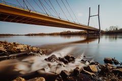 Car bridge over river in city. Siekierkowski bridge over Vistula river in Warsaw, Poland Royalty Free Stock Images
