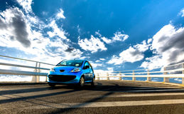 Car on Bridge. Under blue sky with clouds Royalty Free Stock Photo