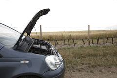 Car Broken Down in Countryside Stock Images