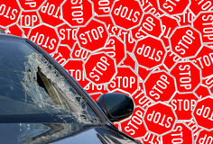 Car with broken windshield on background of stop signs Stock Images