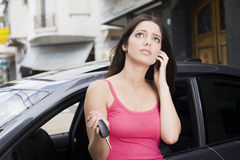 Car broken. Worried woman on the phone with broken car Royalty Free Stock Photography