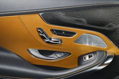 Free Car Brown Leather And Carbon Interior Details Of Door Handle With Windows Power Seat Controls And Adjustments. Luxury Car Inside. Royalty Free Stock Images - 110915549
