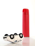 Car bug spray. Hybrid car killed by a can of spray concept Royalty Free Stock Images