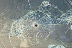 Car with bullet holes in the windshield. The Car with bullet holes in the windshield Stock Photos