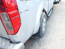 The car was hit by an accident because of abrasions or collapsing. Should be repaired. The car that bumped in the front has dents and has mud attached to the royalty free stock images