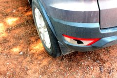 The car was hit by an accident because of abrasions or collapsing. Should be repaired. The car that bumped in the front has dents and has mud attached to the royalty free stock photography
