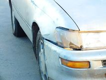 The car was hit by an accident because of abrasions or collapsing. Should be repaired. The car that bumped in the front has dents and has mud attached to the royalty free stock image