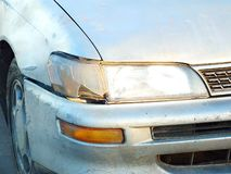 The car was hit by an accident because of abrasions or collapsing. Should be repaired. The car that bumped in the front has dents and has mud attached to the stock photography