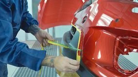 Car bumper after painting in a cars spray booth. Auto vehicle primer bumper. royalty free stock photography