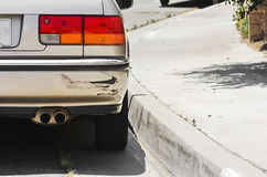 Car Bumper Swiped. Close up of a rear car bumper side swiped Stock Photos
