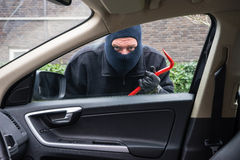 Car burglar in action stock photography