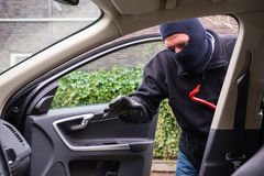 Car burglar in action Stock Photo