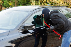 Car burglar in action Royalty Free Stock Photos