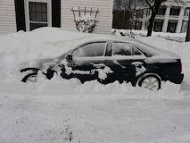 Car buried in snow from storm Nemo Royalty Free Stock Photo