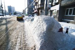 Car covered by Snow on Street Royalty Free Stock Photography
