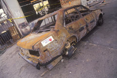 Car burned during 1992 riots, South Central Los Angeles, California Stock Photos