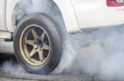 Car burnout. At a drag racing track royalty free stock photography