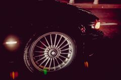 A car burnout at a drag racing track. Car tire Night on the way. Car tires in automobile . luxury car wheel close-up . fuel royalty free stock images